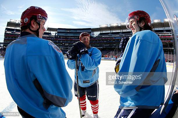 Michael Latta Jason Chimera and Tom Wilson of the Washington Capitals take a break during practice day prior to the 2015 Bridgestone NHL Winter...