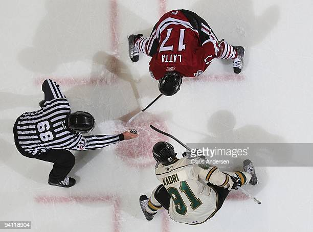 Michael Latta of the Guelph Storm gets set to take a faceoff against Nazem Kadri of the London Knights in a game on December 4 2009 at the John...