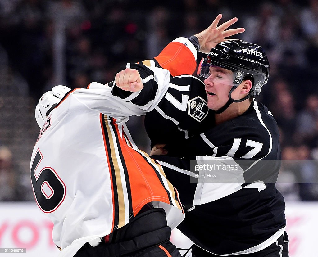 Michael Latta #17 of the Los Angeles Kings fights Simon Despres #6 of the Anaheim Ducks during the third period of a preseason game at Staples Center on September 28, 2016 in Los Angeles, California.