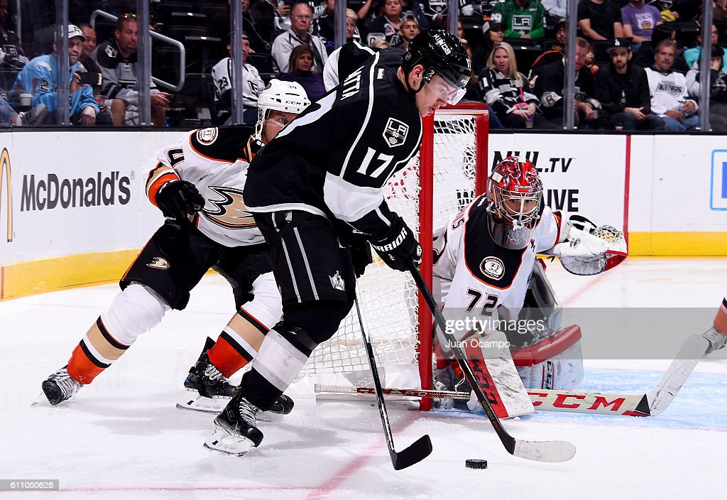 Michael Latta #17 of the Los Angeles Kings handles the puck as Yann Danis #72 of the Anaheim Ducks defends the net during the game on September 28, 2016 at STAPLES Center in Los Angeles, California.