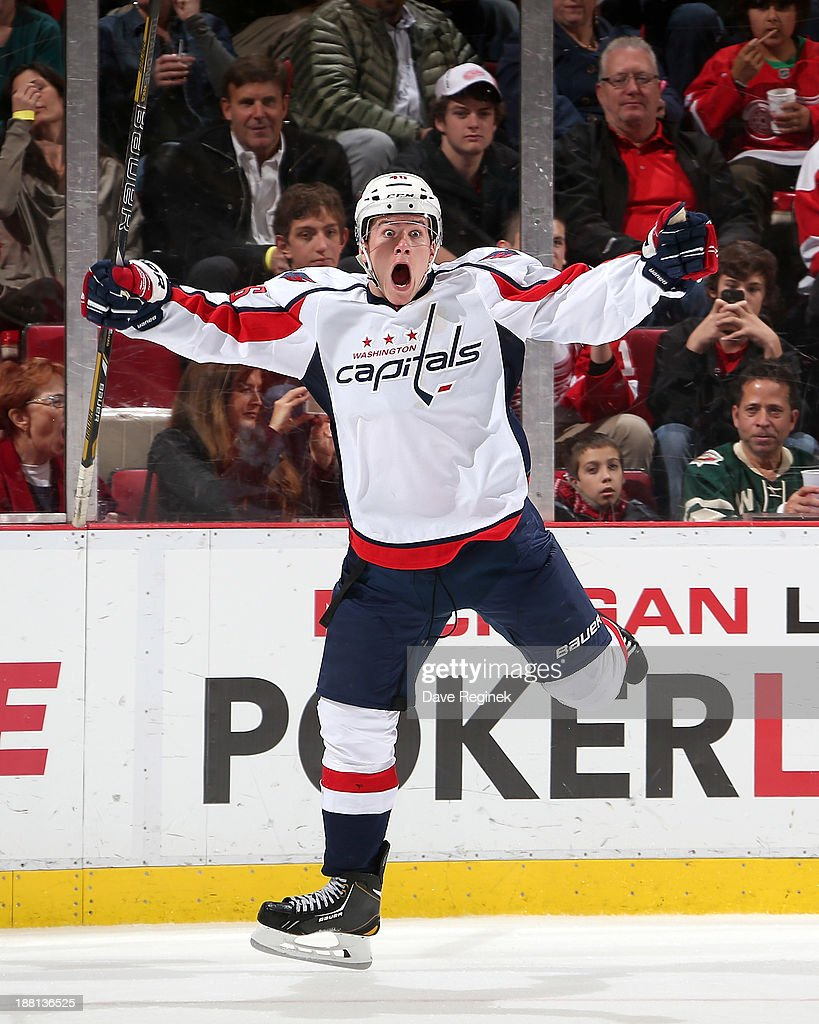 Michael Latta #46 of the Washington Capitals celebrates after scoring a third-period goal to even the score during an NHL game against the Detroit Red Wings at Joe Louis Arena on November 15, 2013 in Detroit, Michigan.