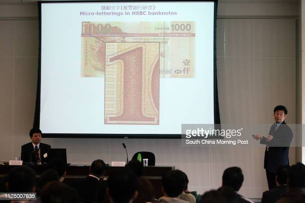 Michael Lau Senior Manager of Hong Kong Monetary Authority given speech at a seminar to bank staff on how to differentiate fake $1000 notes at IFC 2...