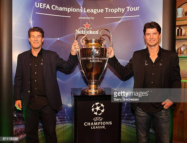 Michael Laudrup and Brian Laudrup attend the Heineken Brings UEFA Champions League Trophy at Fado Irish Pub on March 3 2010 in Chicago Illinois