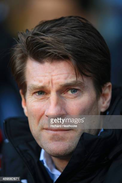 Michael Laudrup manager of Swansea City looks on during the Barclays Premier League match between Aston Villa and Swansea City at Villa Park on...