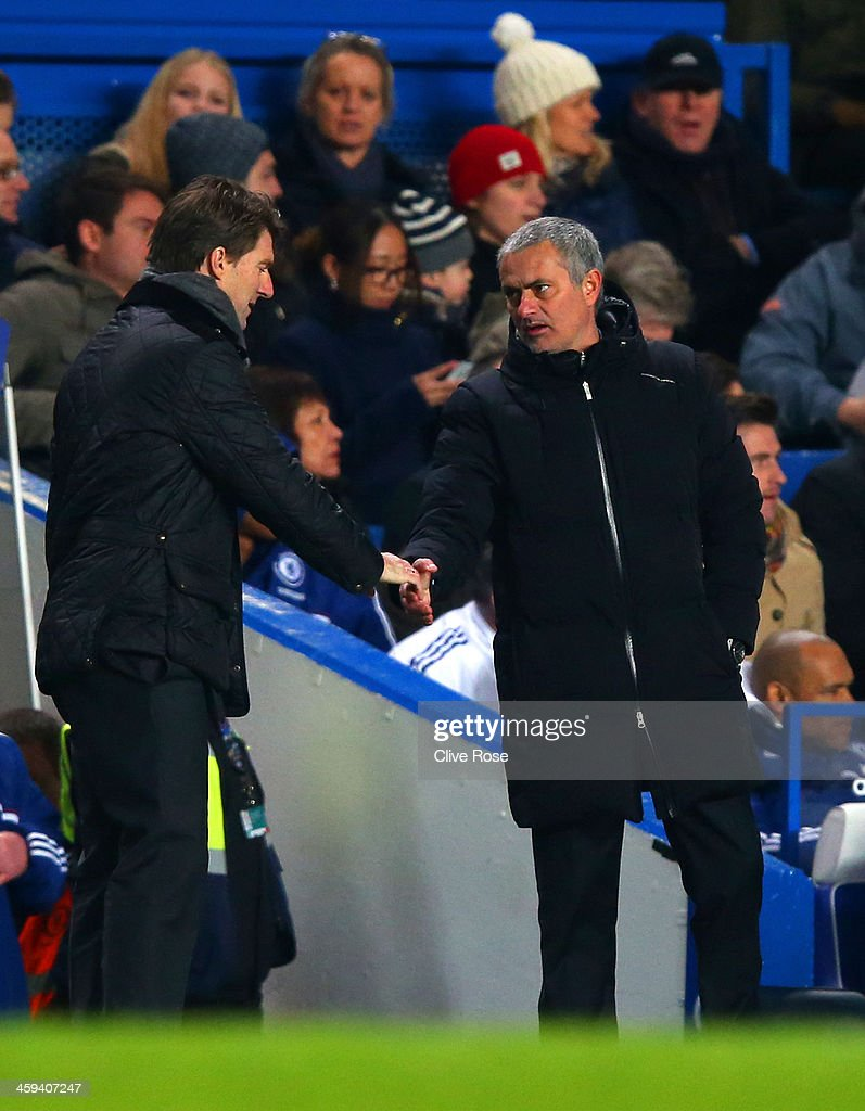 Michael Laudrup manager of Swansea City shakes hands with Jose Mourinho manager of Chelsea at the final whistle during the Barclays Premier League match between Chelsea and Swansea City at Stamford Bridge on December 26, 2013 in London, England.