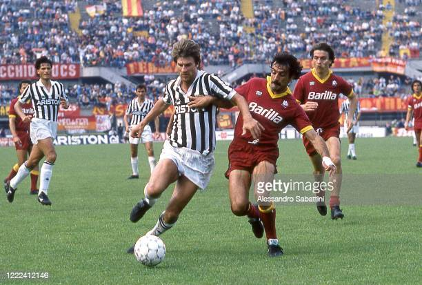 Michael Laudrup of Juvetuscompetes for the ball with Emidio Oddi of AS Roma during the Serie A match between Juventus and AS Roma at stadio Comunale...