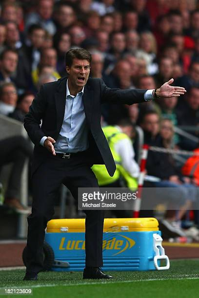 Michael Laudrup the manager of Swansea City points the way from the touchline during the Barclays Premier League match between Swansea City and...