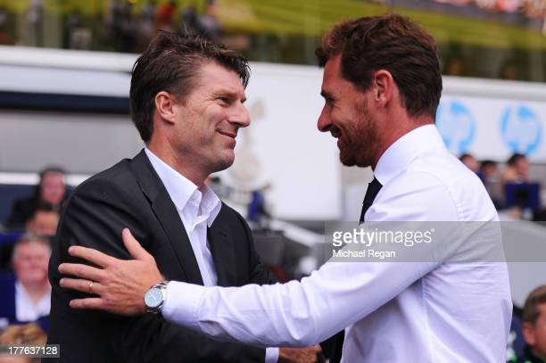 Michael Laudrup the Swansea manager is greeted by Andre VillasBoas the Spurs manager prior to kick off during the Barclays Premier League match...