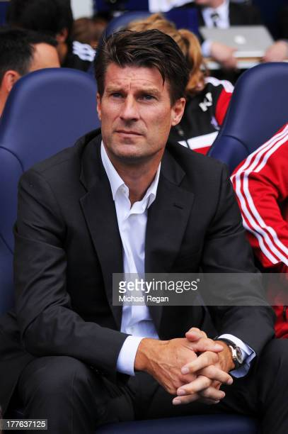 Michael Laudrup the Swansea manager looks on prior to kick off during the Barclays Premier League match between Tottenham Hotspur and Swansea City at...