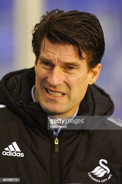 Michael Laudrup the Swansea manager looks on prior to kickoff during the FA Cup fourth round match between Birmingham City and Swansea City at St...