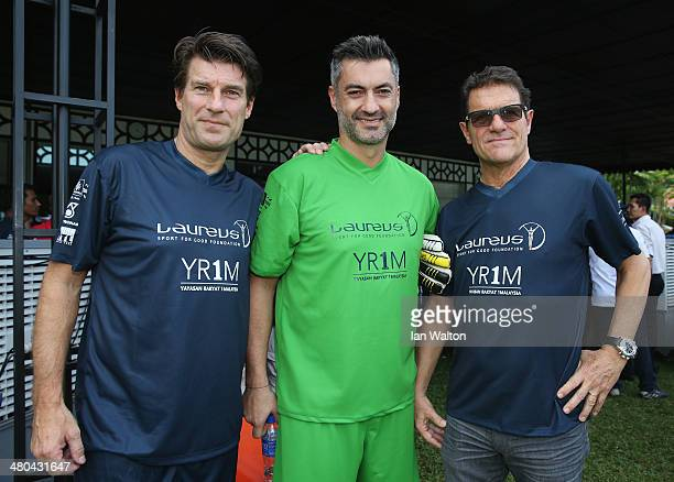 Michael Laudrup Vitor Baia and Fabio Capello look on during the Laureus All Stars Unity Cup ahead of the 2014 Laureus World Sports Awards at Royal...