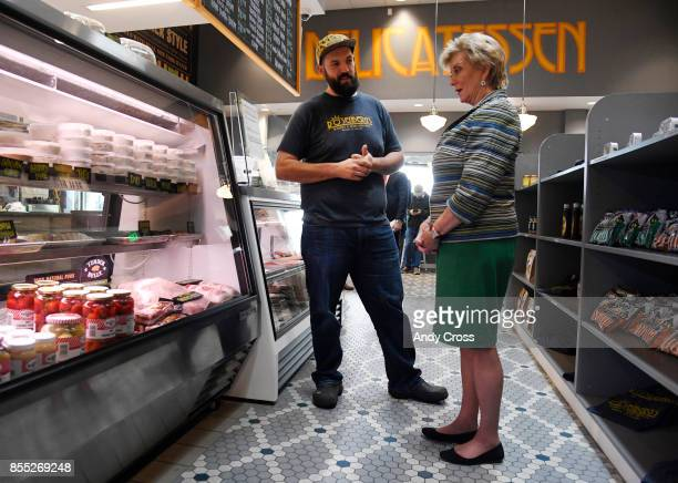 Michael Lavery left GM of Rosenberg's Bagels and Delicatessen talks with Small Business Association administrator Linda McMahon inside Rosenberg's at...