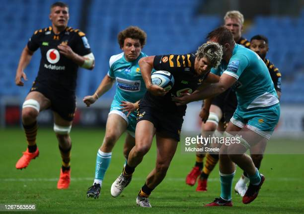 Michael Le Bourgeois of Wasps is held up by Tom Dodd of Worcester during the Gallagher Premiership Rugby match between Wasps and Worcester Warriors...