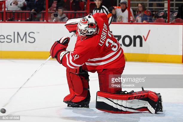 Michael Leighton of the Carolina Hurricanes clears the puck from the crease in the waning seconds of the third period during an NHL game against the...