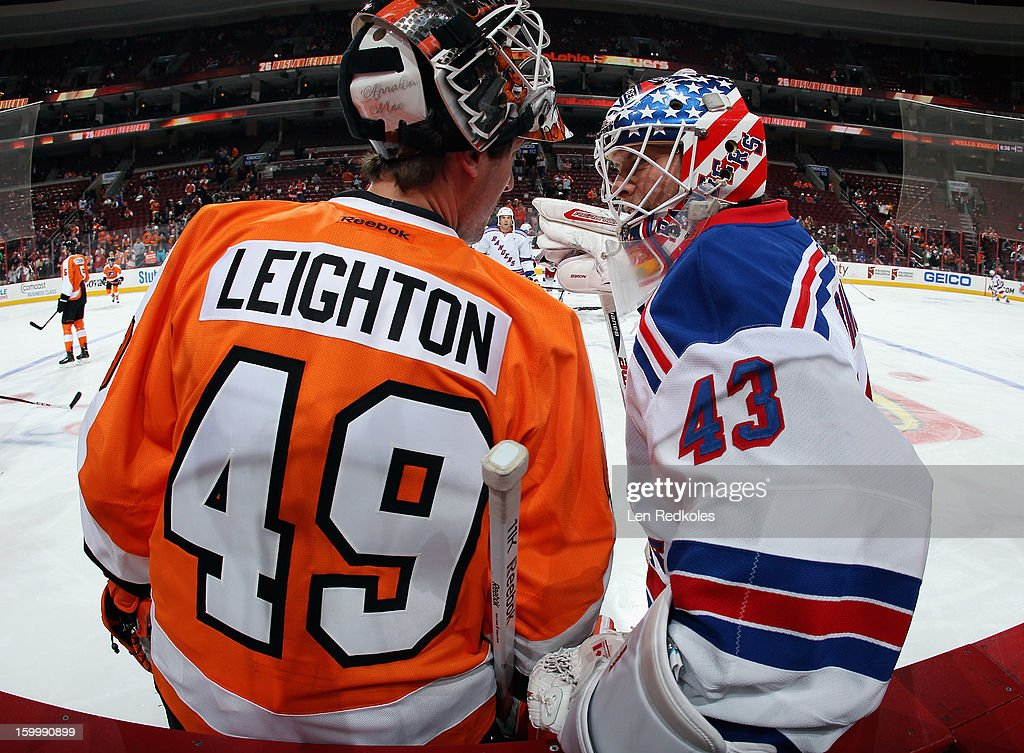 Michael Leighton #49 of the Philadelphia Flyers chats with Martin Biron #43 of the New York Rangers during warmups prior to their game on January 24, 2013 at the Wells Fargo Center in Philadelphia, Pennsylvania.