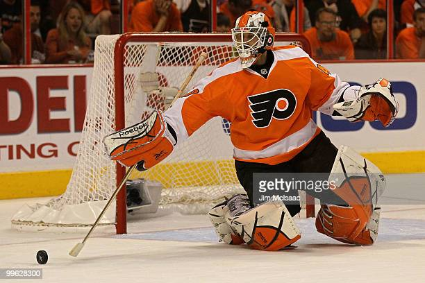 Michael Leighton of the Philadelphia Flyers clears the puck against the Montreal Canadiens in Game 1 of the Eastern Conference Finals during the 2010...