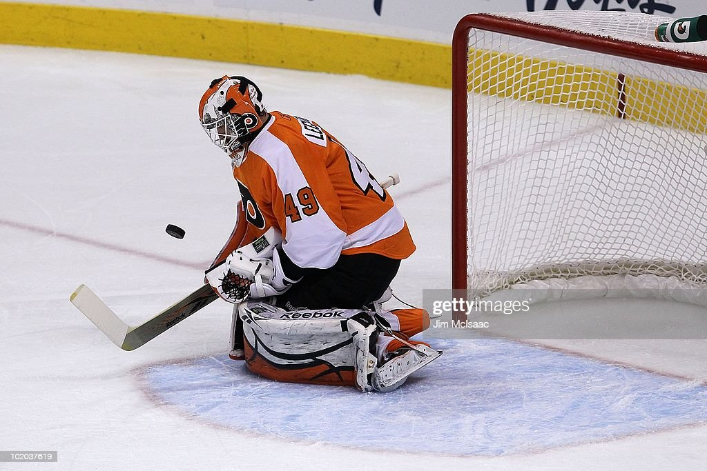 Michael Leighton #49 of the Philadelphia Flyers handles the puck against the Chicago Blackhawks in Game Six of the 2010 NHL Stanley Cup Final at the Wachovia Center on June 9, 2010 in Philadelphia, Pennsylvania.