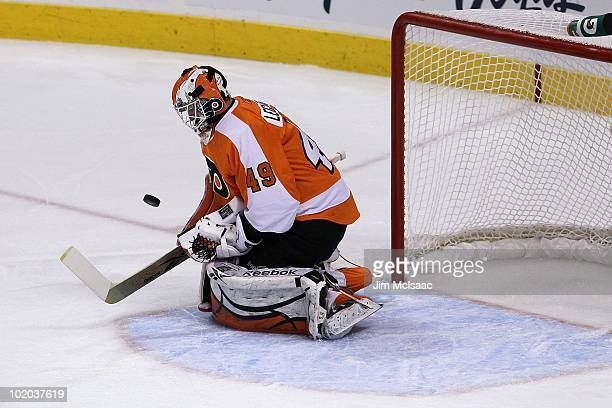 Michael Leighton of the Philadelphia Flyers handles the puck against the Chicago Blackhawks in Game Six of the 2010 NHL Stanley Cup Final at the...