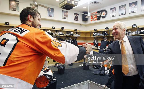 Michael Leighton of the Philadelphia Flyers is congratulated by Flyers Chairman Ed Snider after shutting out the Montreal Canadiens 60 in Game One of...