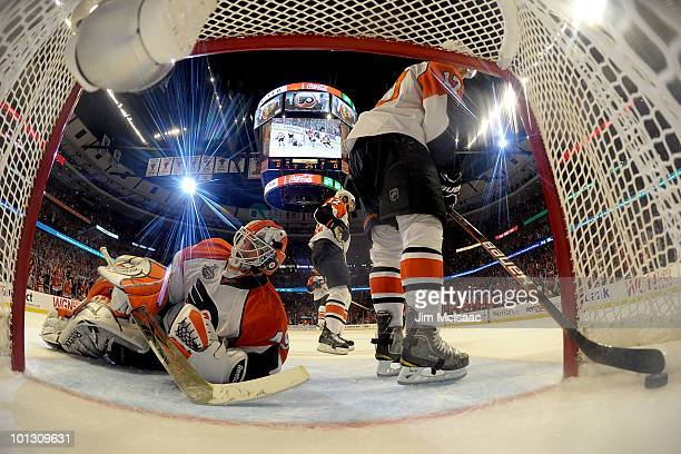 Michael Leighton of the Philadelphia Flyers lays on the ice after allowing a second period goal to Marian Hossa of Chicago Blackhawks in Game Two of...