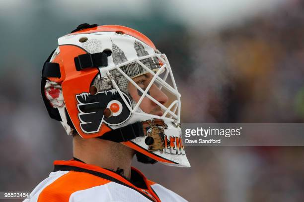 Michael Leighton of the Philadelphia Flyers looks on against the Boston Bruins during the 2010 Bridgestone NHL Winter Classic at Fenway Park on...