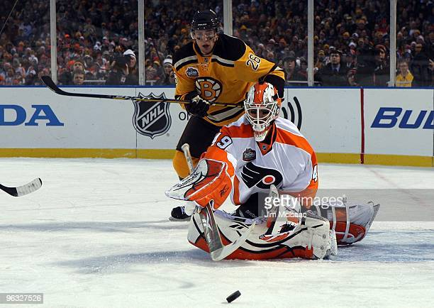 ac425add9 Michael Leighton of the Philadelphia Flyers makes a save under pressure  from David Krejci of the. 2010 Bridgestone Winter Classic ...