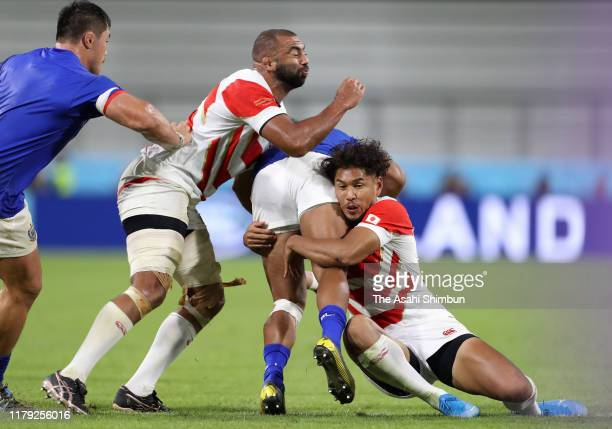 Michael Leitch and Ryohei Yamanaka of Japan tackle during the Rugby World Cup 2019 Group A game between Japan and Samoa at City of Toyota Stadium on...