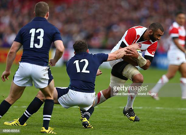 Michael Leitch of Japan is tackled by Matt Scott of Scotland during the 2015 Rugby World Cup Pool B match between Scotland and Japan at Kingsholm...
