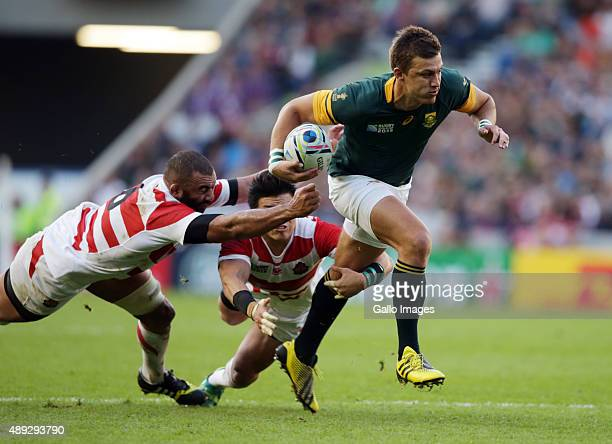 Michael Leitch of Japan looks to make a tackle on Handre Pollard of South Africa during the Rugby World Cup 2015 Pool B match between South Africa...