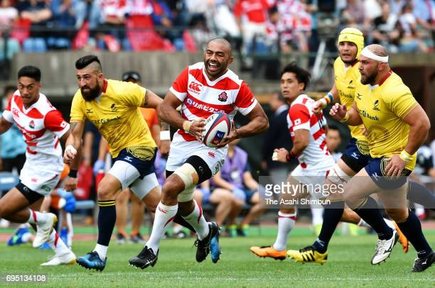 Michael Leitch of Japan makes a break to score his side's third try with his team mates during the international test match between Japan and Romania...