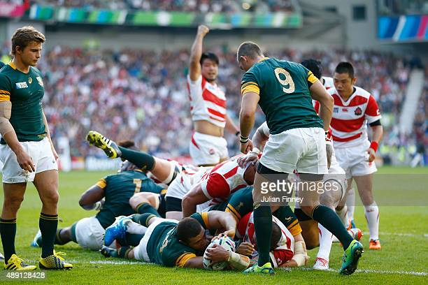 Michael Leitch of Japan scores his team's first try during the 2015 Rugby World Cup Pool B match between South Africa and Japan at the Brighton...