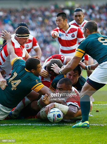 Michael Leitch of Japan scores the first try for his team during the 2015 Rugby World Cup Pool B match between South Africa and Japan at the Brighton...