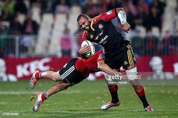 Michael Leitch of the Chiefs is tackled by David Havili of the Crusaders during the round 10 Super Rugby match between the Crusaders and the Chiefs...