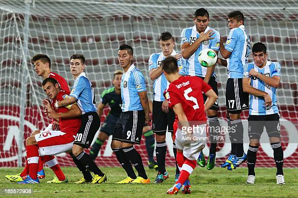 Michael Lercher of Austria tries to score with a freekick during the FIFA U-17 World Cup UAE 2013 Group E match between Argentina and Austria at Al...