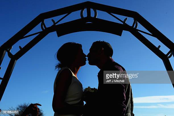 Michael Lewis and Rebecca Anderson kiss outside the Gretna Green Famous Blacksmiths Shop on the day of their wedding on Valentine's day on February...