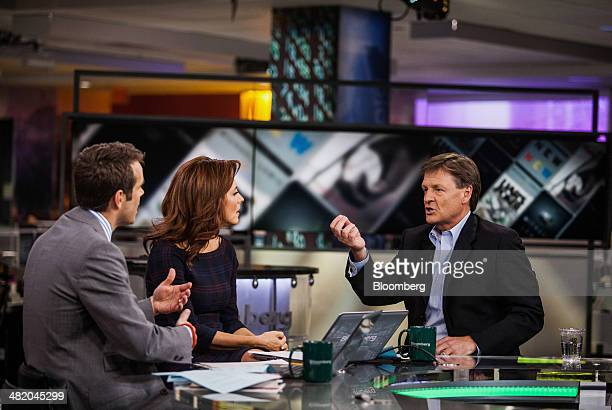 Michael Lewis author of 'Flash Boys' right speaks during a Bloomberg Television interview in New York US on Wednesday April 2 2014 Lewis and Brad...