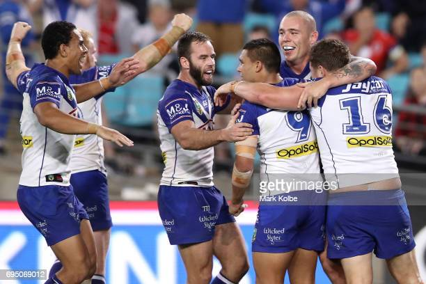 Michael Lichaa of the Bulldogs celebrates with his team mates after scoring a try during the round 14 NRL match between the Canterbury Bulldogs and...