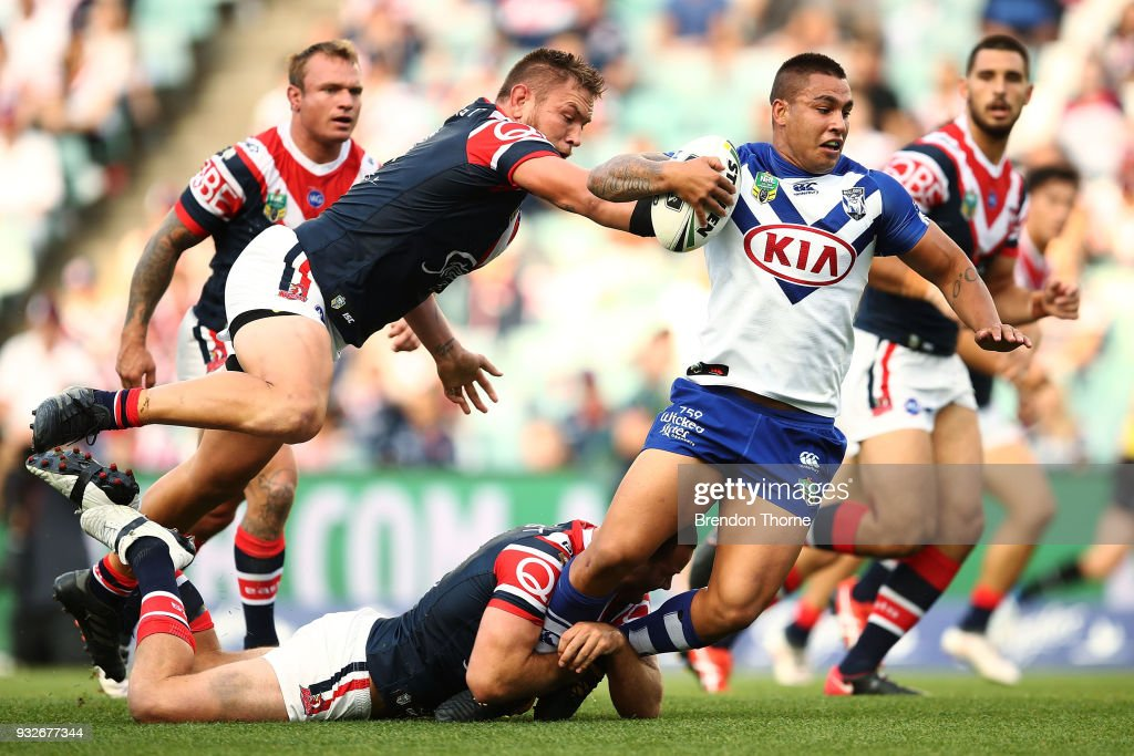 Michael Lichaa of the Bulldogs is tackled by Roosters defence during the round two NRL match between the Sydney Roosters and the Canterbury Bulldogs at Allianz Stadium on March 16, 2018 in Sydney, Australia.