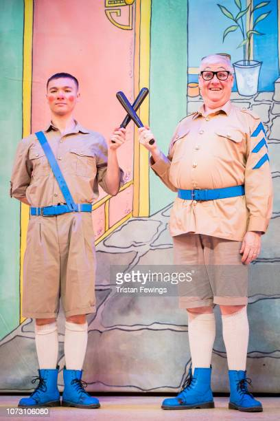 Michael Lin as Constable Ackee and Tony Whittle as Sergeant Dumpling pose during a photocall for Hackney Empire's 20th Anniversary pantomime...