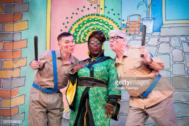 Michael Lin as Constable Ackee Tameka Empson as The Empress and Tony Whittle as Sergeant Dumpling pose during a photocall for Hackney Empire's 20th...