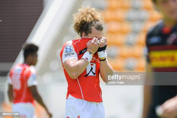Michael Little of Sunwolves wipes his face during the Super Rugby match between Sunwolves and Stormers at Mong Kok Stadium on May 19 2018 in Hong Kong