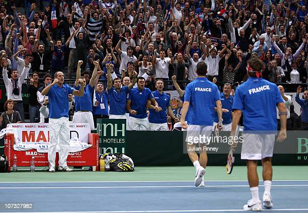 Michael Llodra and Arnaud Clement of France celebrate defeating Nenad Zimonjic and Viktor Troicki of Serbia in the doubles during day two of the...