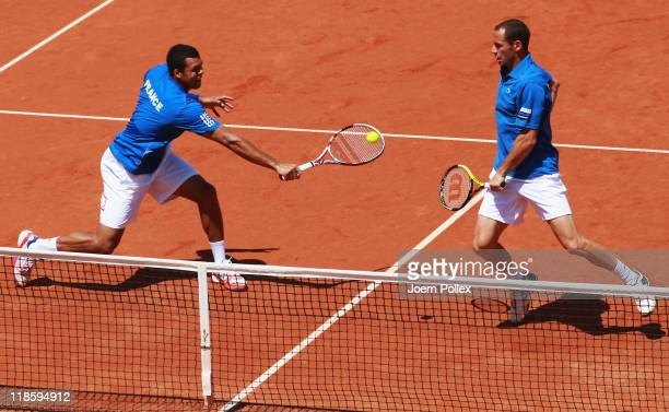 Michael Llodra and Jo-Wilfried Tsonga of France action during their doubles match against Christopher Kas and Philipp Petzschner of Germany during...