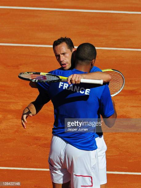 Michael Llodra and JoWilfried Tsonga of France celebrate matchpoint during day two of the semi final Davis Cup match between Spain and France on...