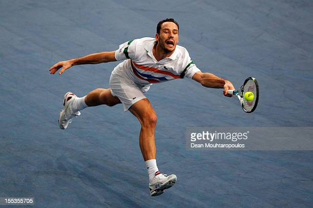 Michael Llodra of France in action against David Ferrer of Spain in their Semi Final match on day 6 of the BNP Paribas Masters at Palais Omnisports...