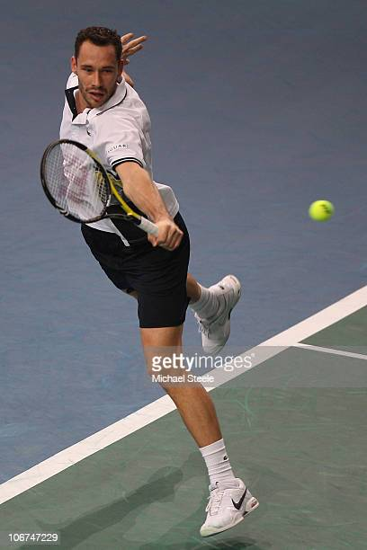 Michael Llodra of France in action against Novak Djokovic of Serbia during Day Five of the ATP Masters Series Paris at the Palais Omnisports on...