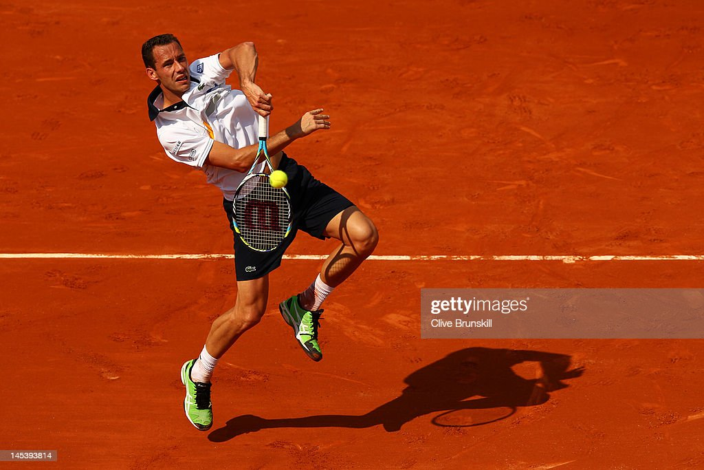 Michael Llodra of France leaps to volley the ball in the men's singles first round match between Michael Llodra of France and Guillermo Garcia-Lopez of Spain during day two of the French Open at Roland Garros on May 28, 2012 in Paris, France.
