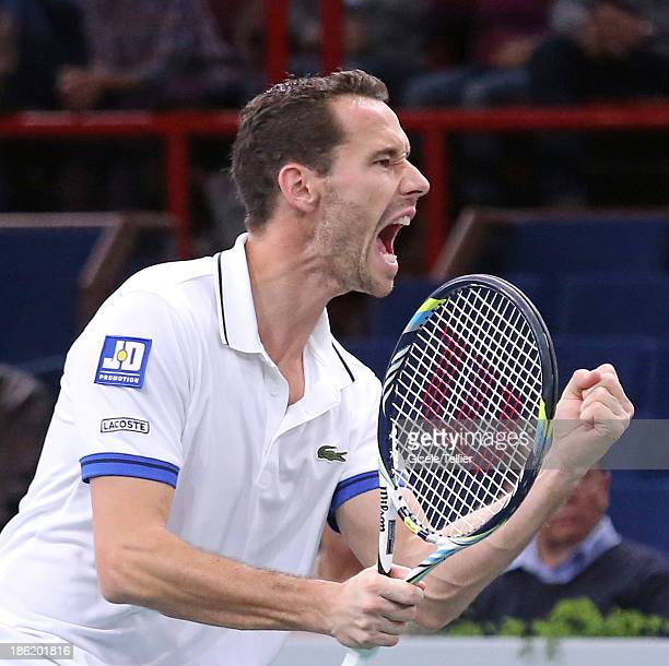 Michael LLodra of France reacts after a point during his first round match against Grigor Dimitrov of Bulgaria during the BNP Paribas Masters at...