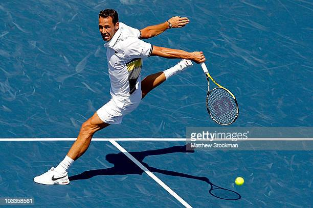 Michael Llodra of France returns a shot to Roger Federer of Switzerland during the Rogers Cup at the Rexall Centre on August 12 2010 in Toronto Canada