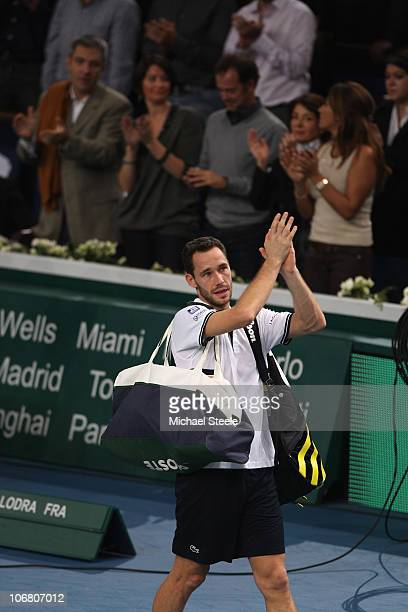 Michael Llodra of France walks off centre court after his 7-6,5-7,6-7 defeat against Robin Soderling of Sweden in the semi-final during Day Seven of...